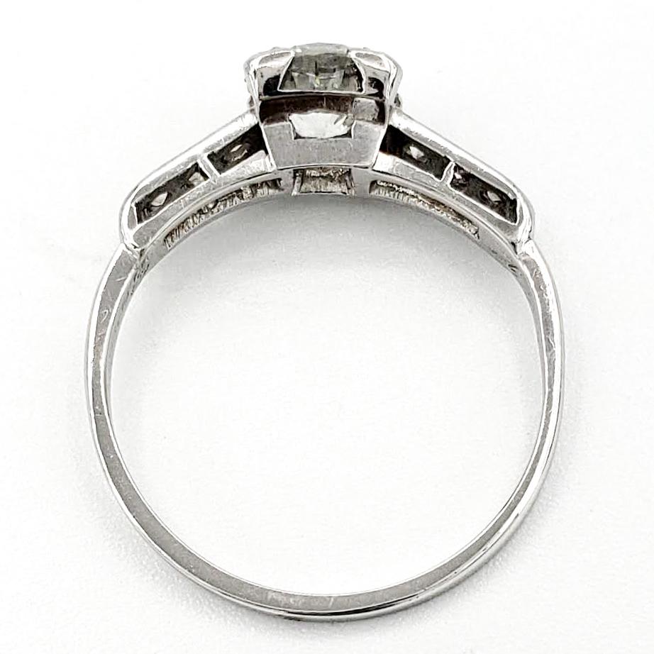 vintage-platinum-engagement-ring-with-0-68-carat-round-brilliant-cut-diamond-egl-f-vs2