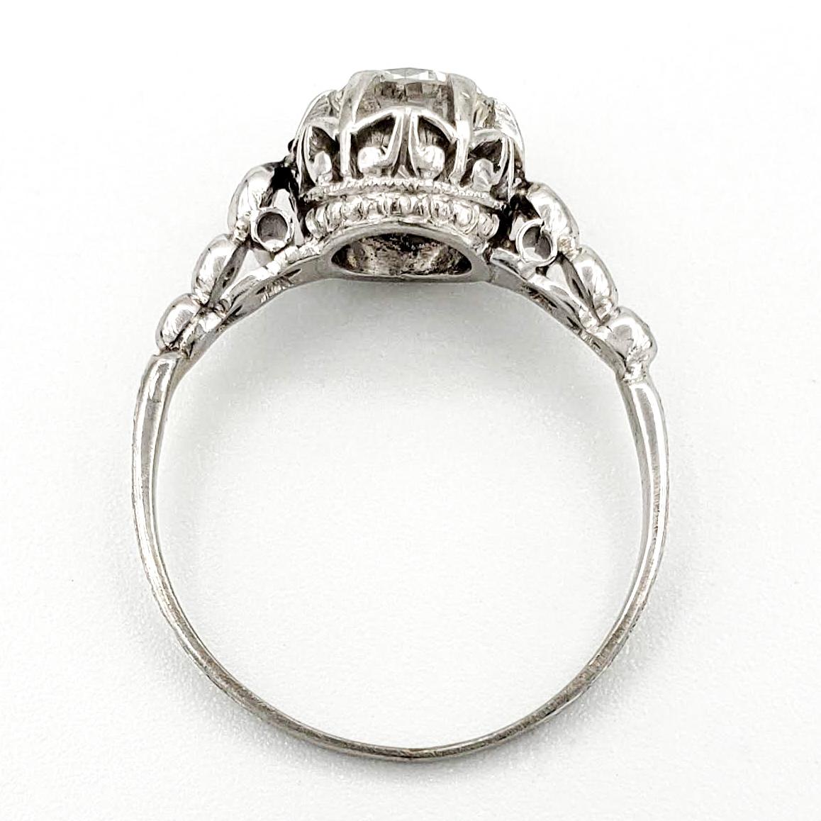 vintage-platinum-engagement-ring-with-0-57-carat-round-brilliant-cut-diamond-egl-f-si2