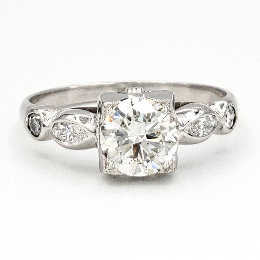 vintage-platinum-engagement-ring-with-0-69-carat-round-brilliant-cut-diamond-egl-h-vs2
