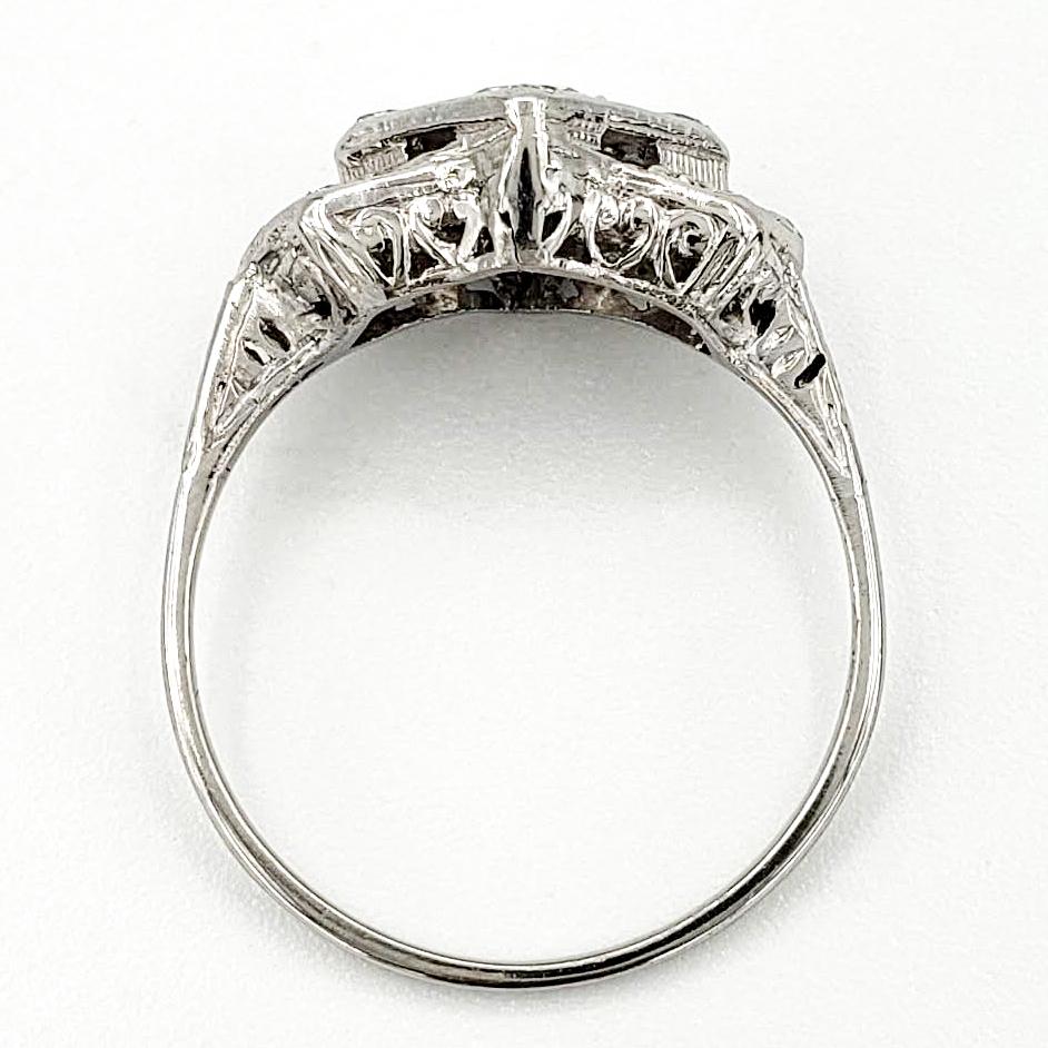 vintage-platinum-engagement-ring-with-0-51-carat-old-european-cut-diamond-egl-f-si1
