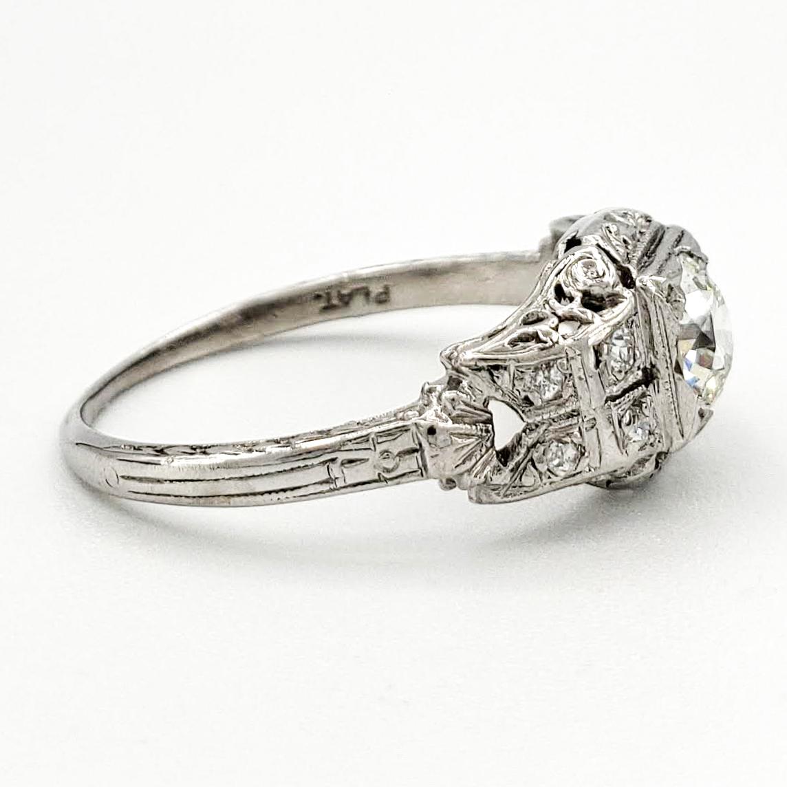 vintage-platinum-engagement-ring-with-0-32-carat-old-european-cut-diamond-egl-h-vs2
