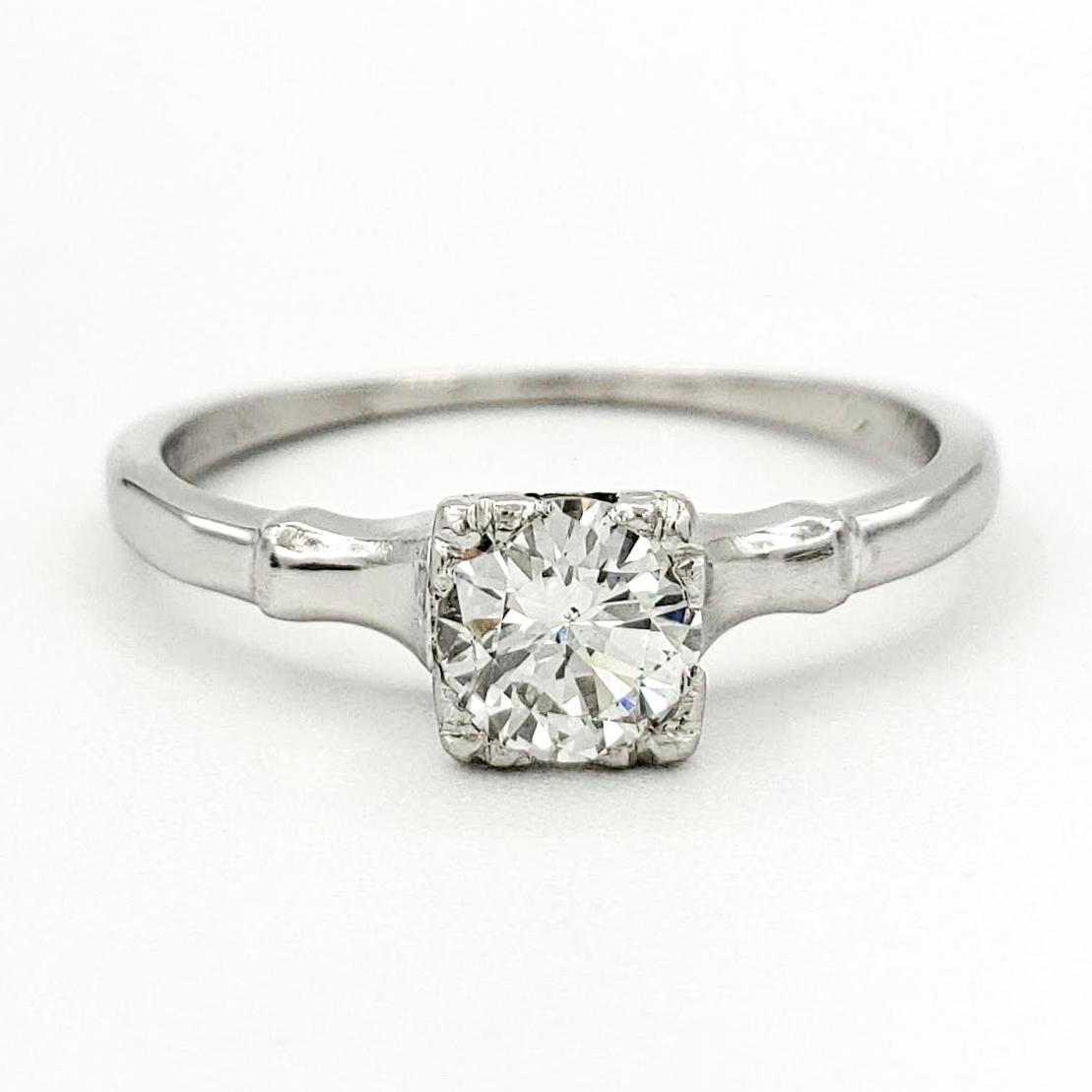 vintage-platinum-engagement-ring-with-0-41-round-brilliant-cut-diamond-egl-g-si1