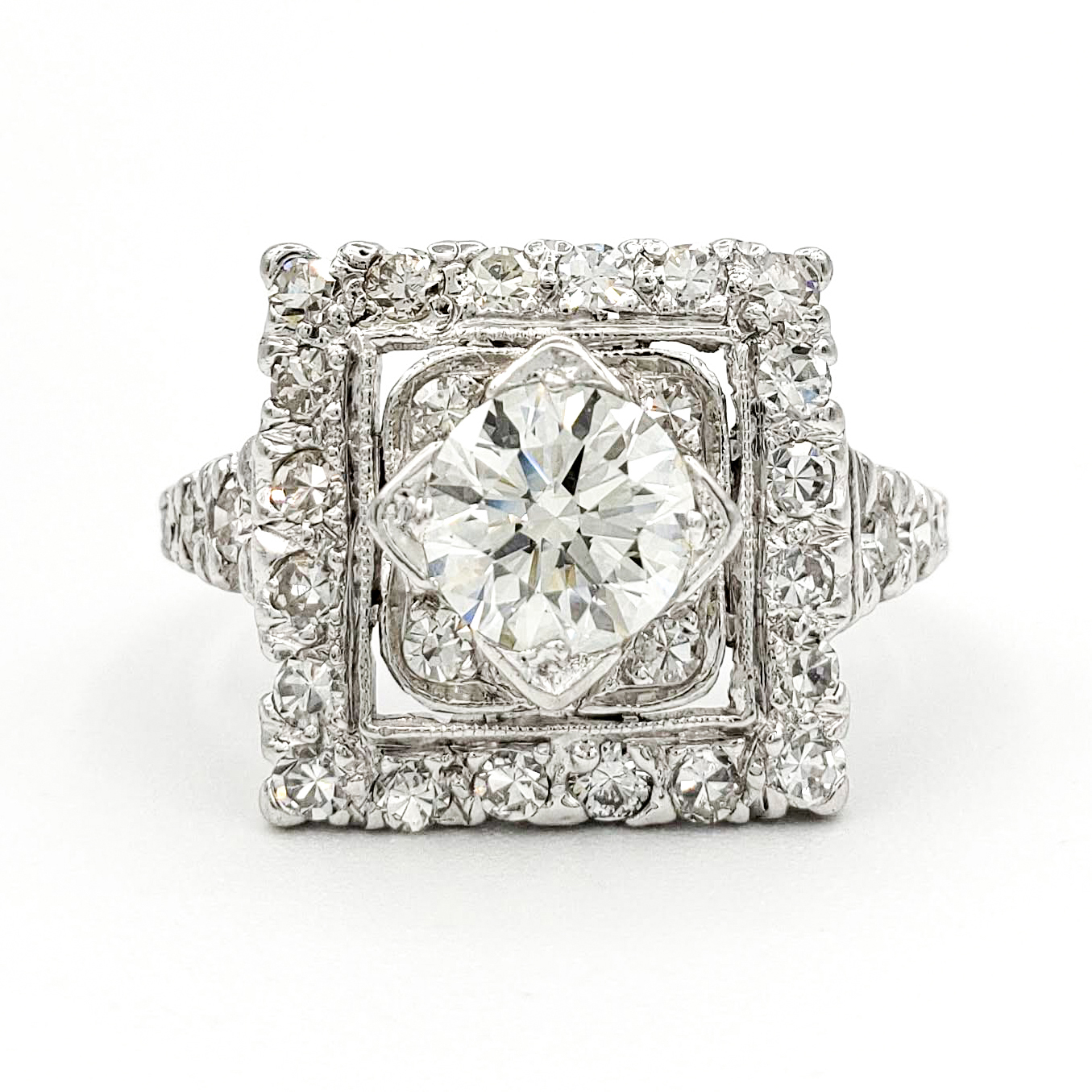 vintage-platinum-engagement-ring-with-0-74-carat-round-brilliant-cut-diamond-egl-h-vs1