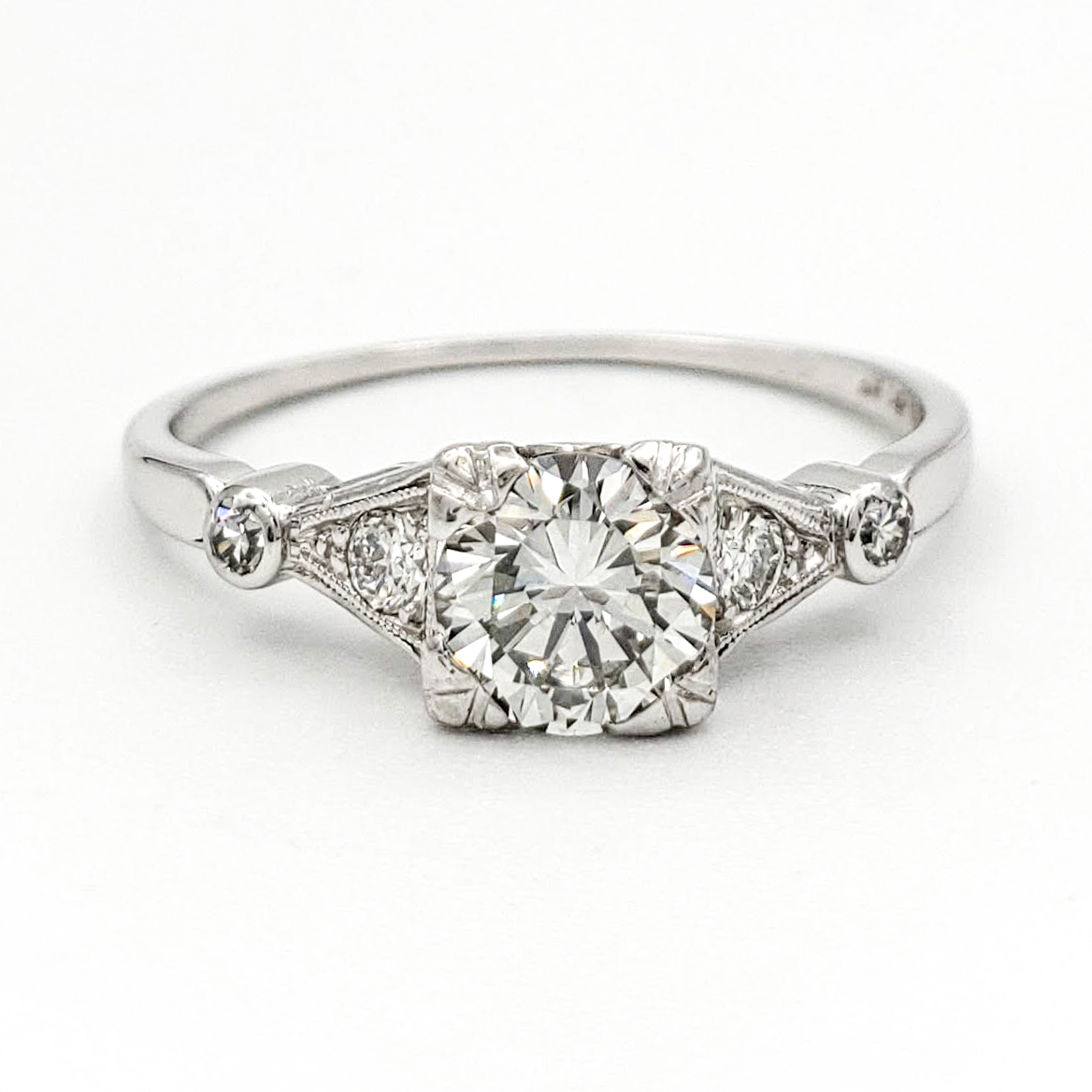 vintage-platinum-engagement-ring-with-0-57-carat-round-brilliant-cut-diamond-egl-g-vs2