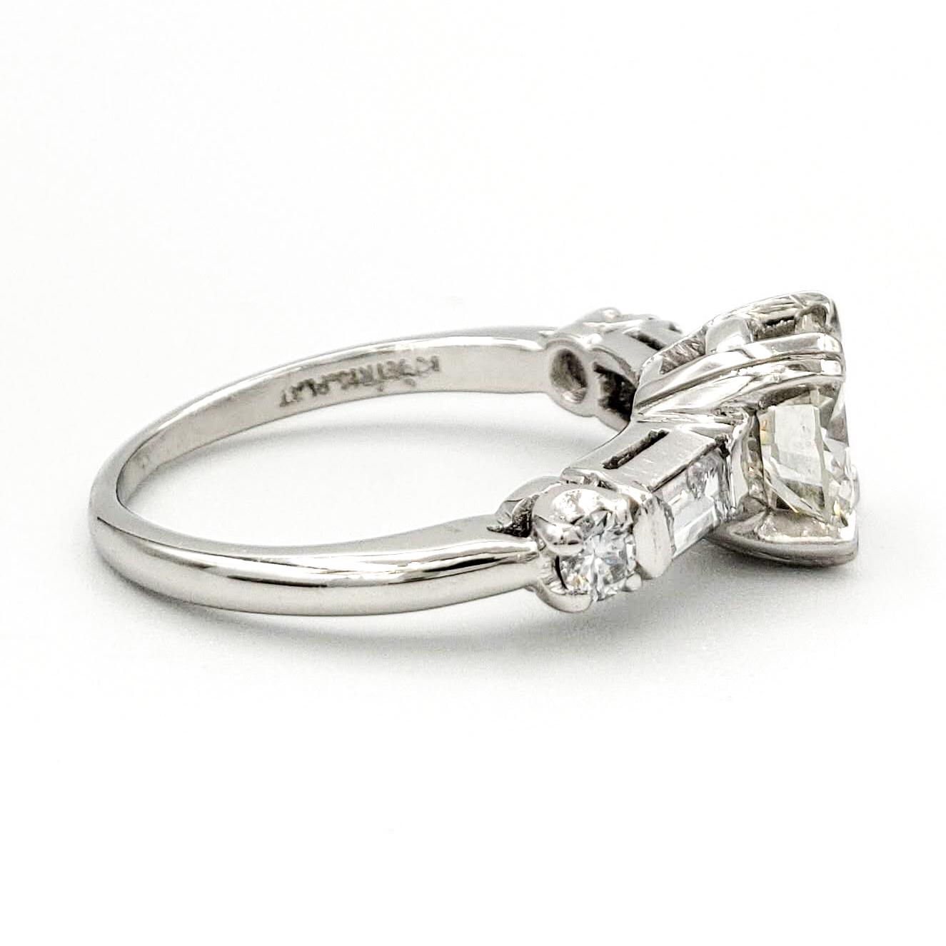 vintage-platinum-engagement-ring-with-0-97-carat-round-brilliant-cut-diamond-egl-h-vs1