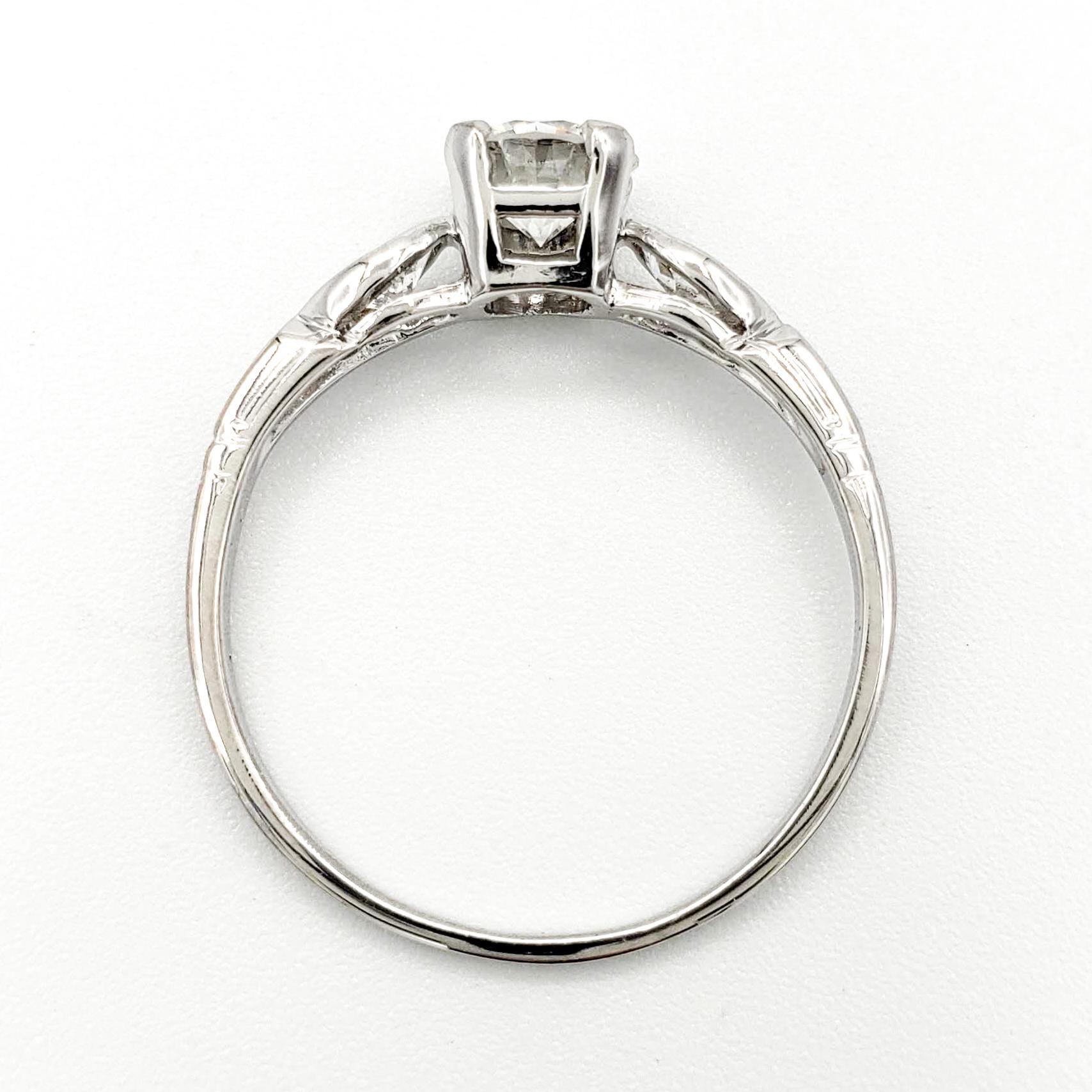 vintage-platinum-engagement-ring-with-0-56-carat-round-brilliant-cut-diamond-gia-g-vs2
