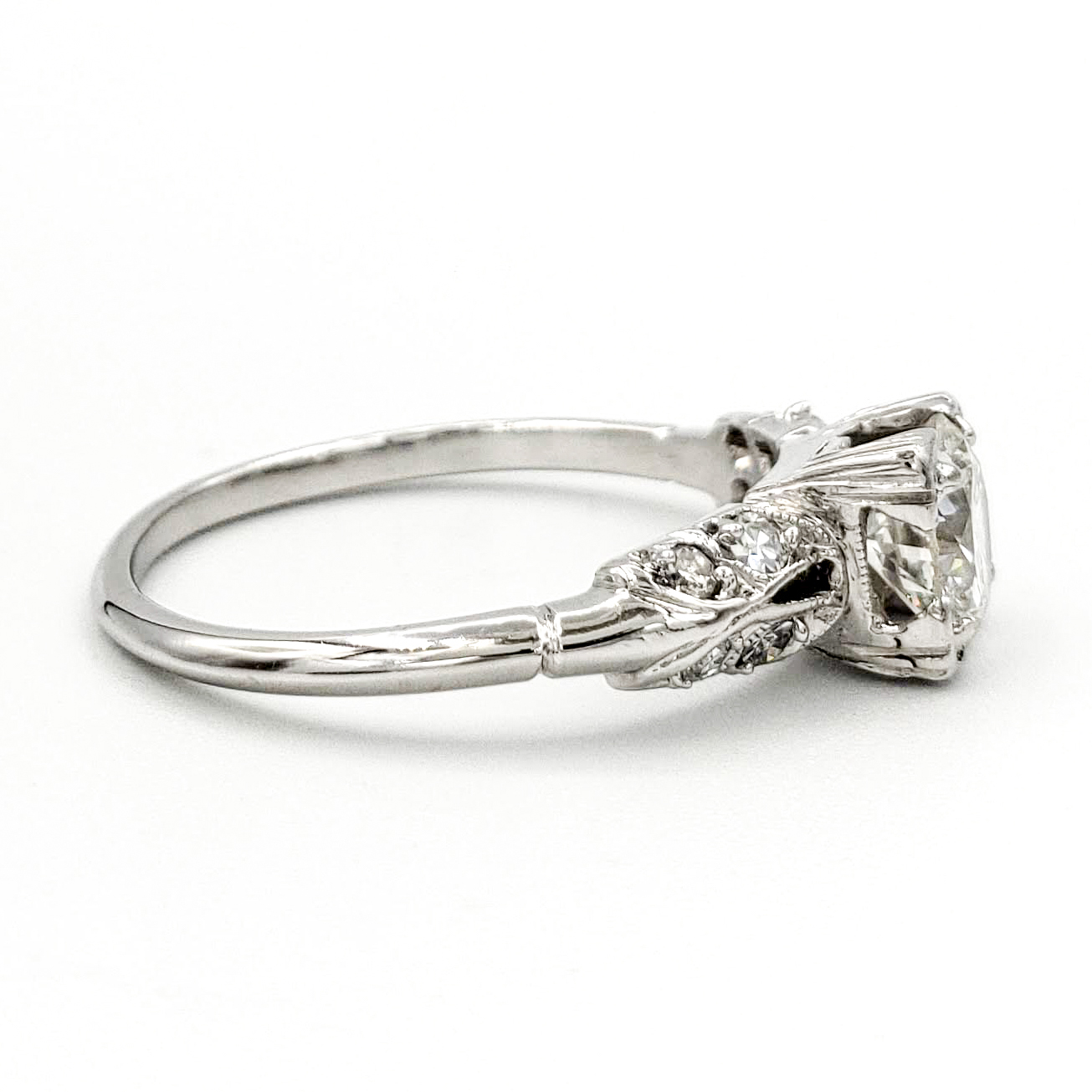 vintage-platinum-engagement-ring-with-0-68-carat-round-brilliant-cut-diamond-egl-h-vs1