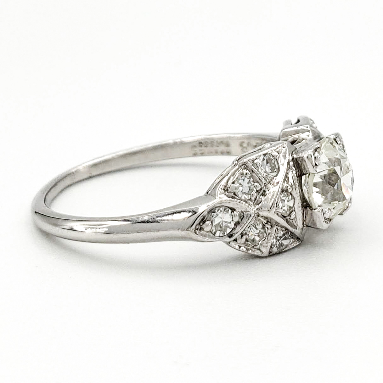 vintage-platinum-engagement-ring-with-0-57-carat-old-european-cut-diamond-egl-j-vs1