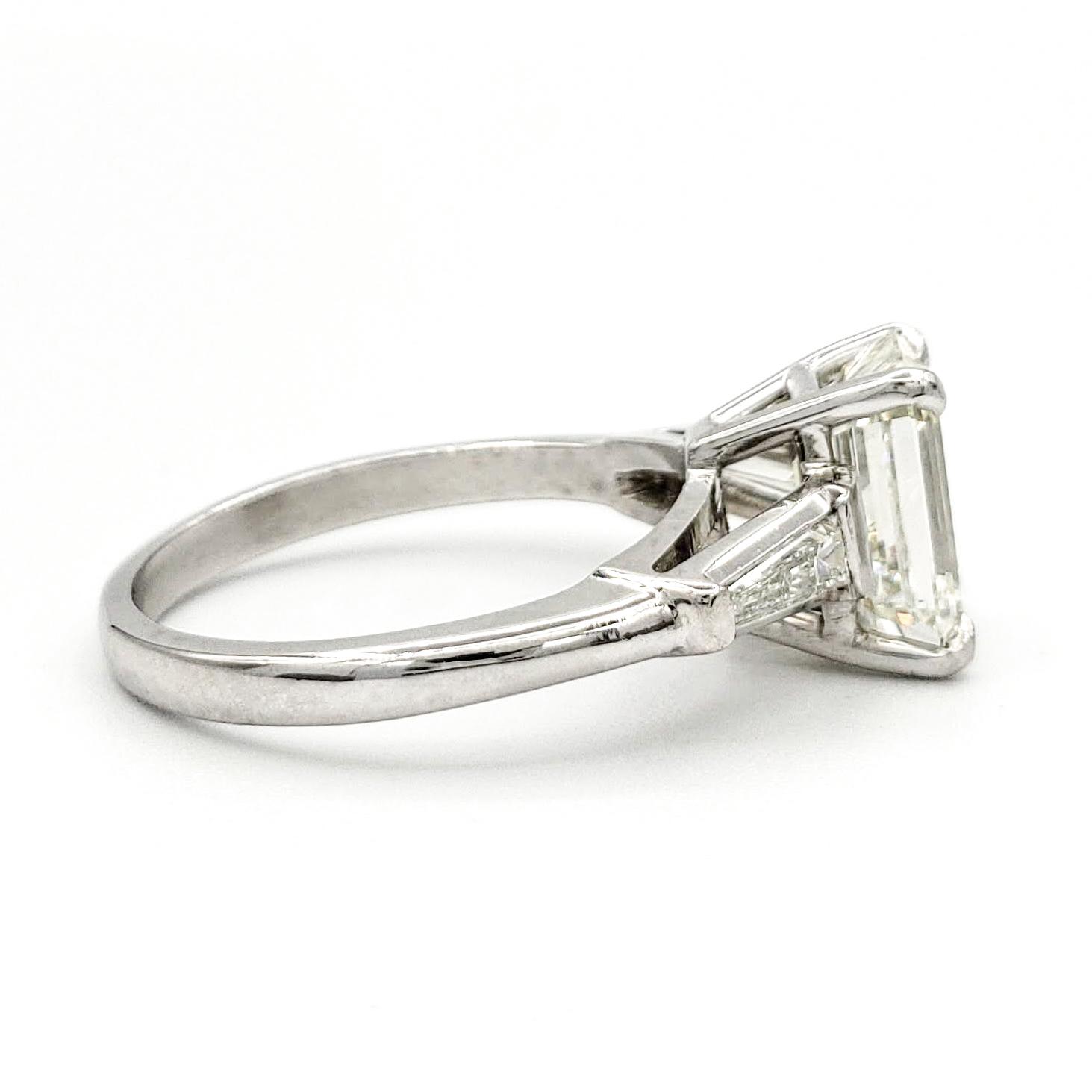 vintage-platinum-engagement-ring-with-2-30-carat-emerald-cut-diamond-gia-m-vs2