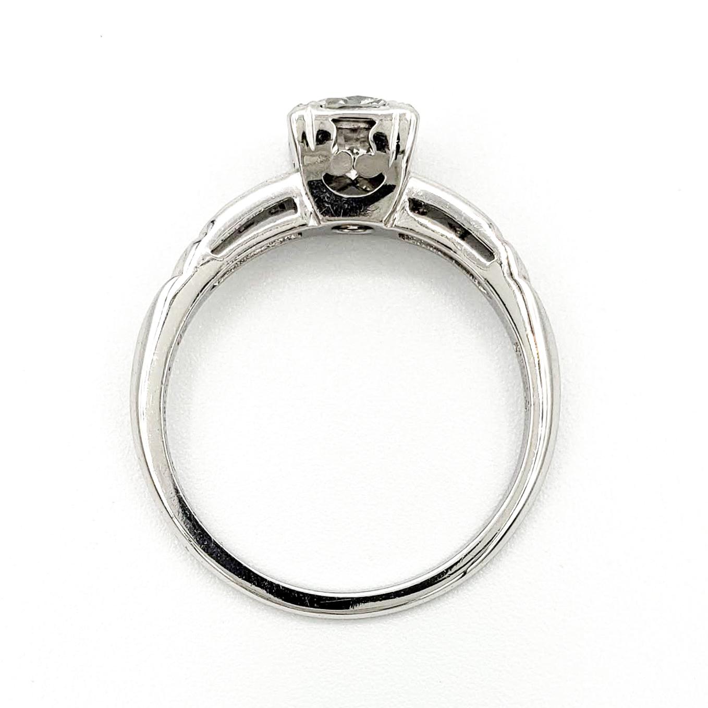 vintage-platinum-engagement-ring-with-0-64-carat-round-brilliant-cut-diamond-egl-e-vs2