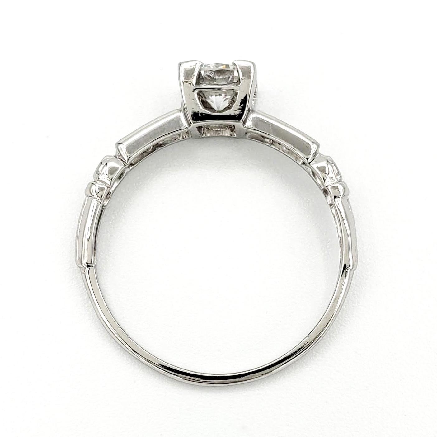 vintage-platinum-engagement-ring-with-0-42-carat-round-brilliant-cut-diamond-egl-e-vs2