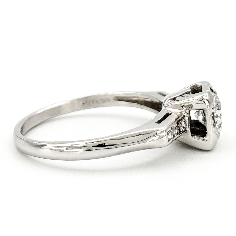 vintage-platinum-engagement-ring-with-0-58-carat-round-brilliant-cut-diamond-egl-e-vs1