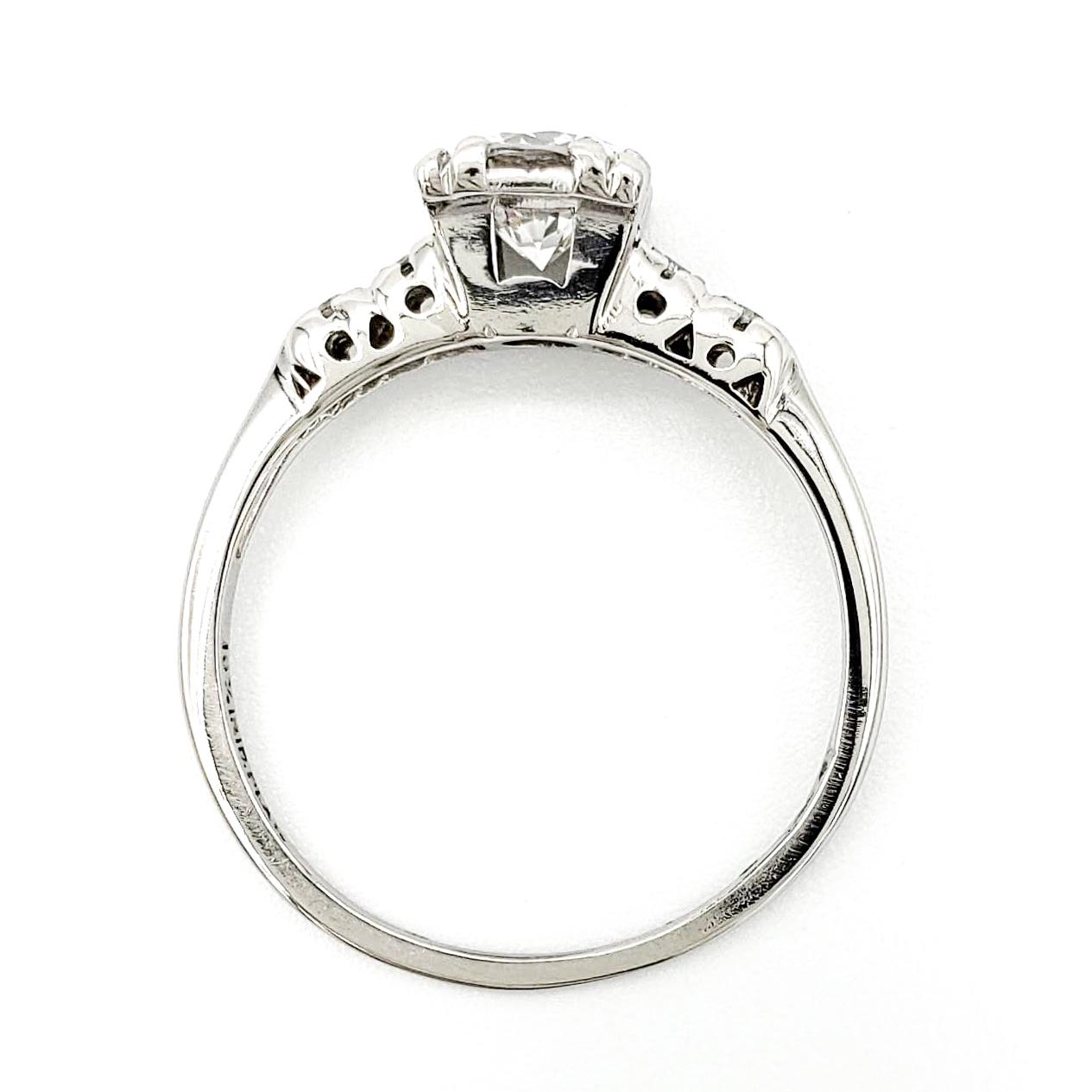 vintage-platinum-engagement-ring-with-0-63-carat-round-brilliant-cut-diamond-egl-e-si1