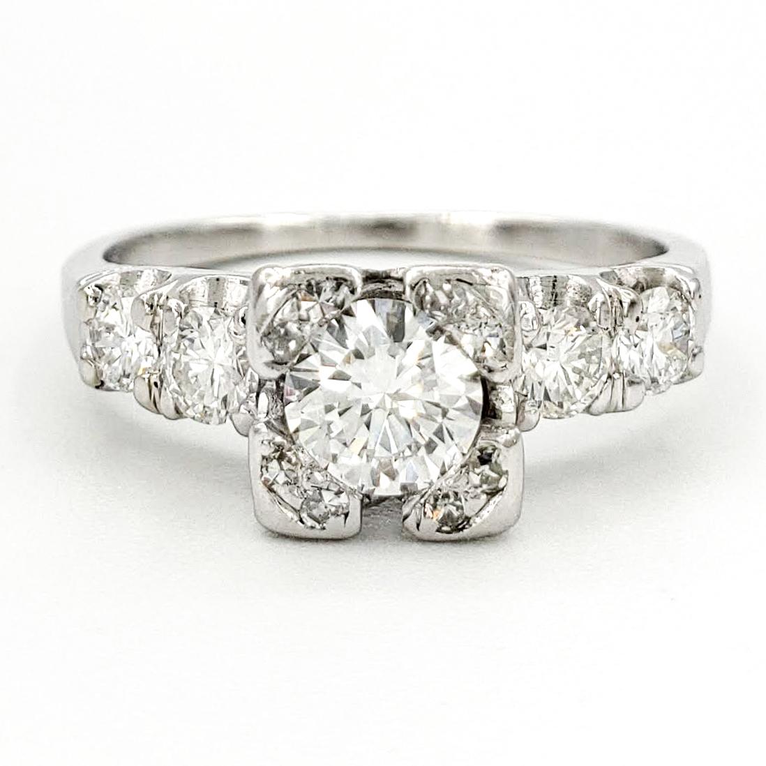vintage-platinum-engagement-ring-with-0-38-carat-round-brilliant-cut-diamond-egl-e-si1