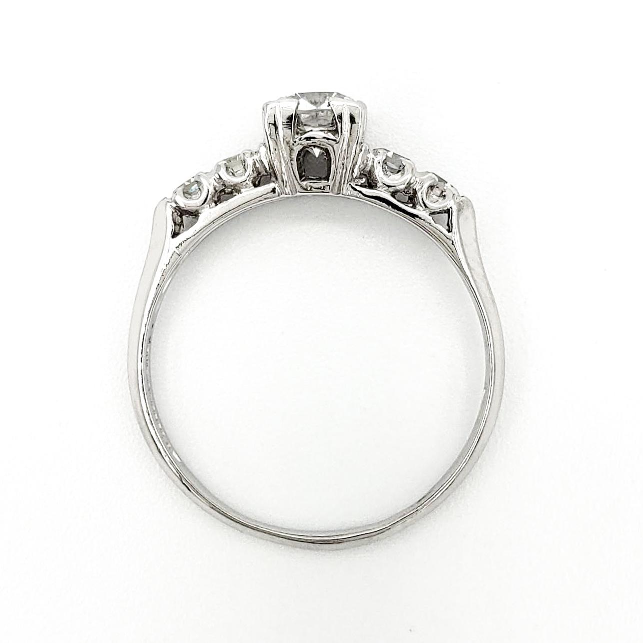 vintage-platinum-engagement-ring-with-0-41-carat-round-brilliant-cut-diamond-egl-e-vs1