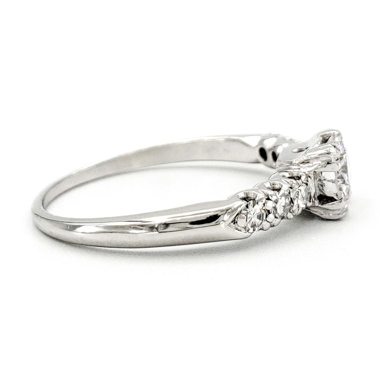 vintage-platinum-engagement-ring-with-0-52-carat-round-brilliant-cut-diamond-egl-e-si1