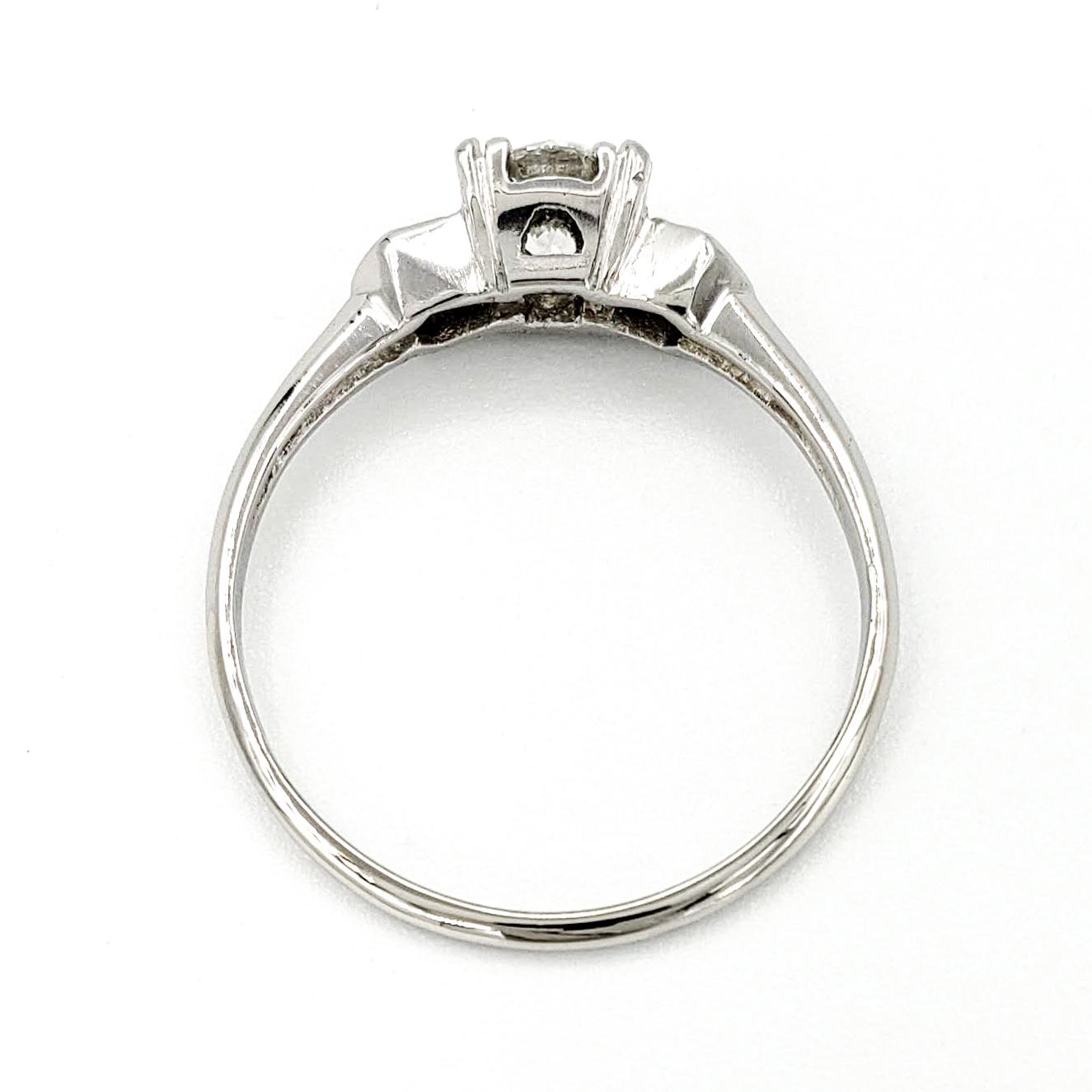 vintage-platinum-engagement-ring-with-0-57-carat-round-brilliant-cut-diamond-gia-i-vs2