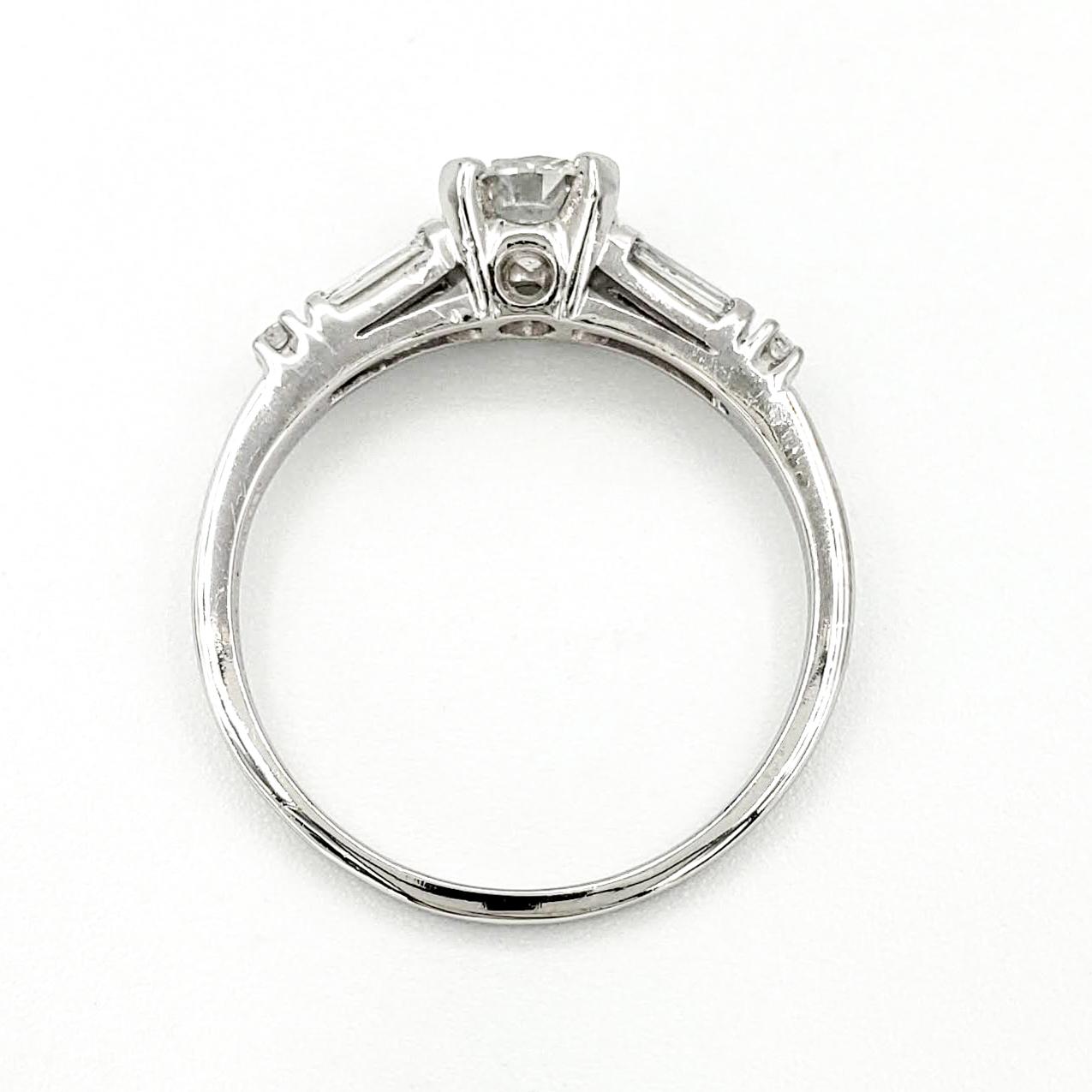 vintage-platinum-engagement-ring-with-0-56-carat-round-brilliant-cut-diamond-egl-e-vs1