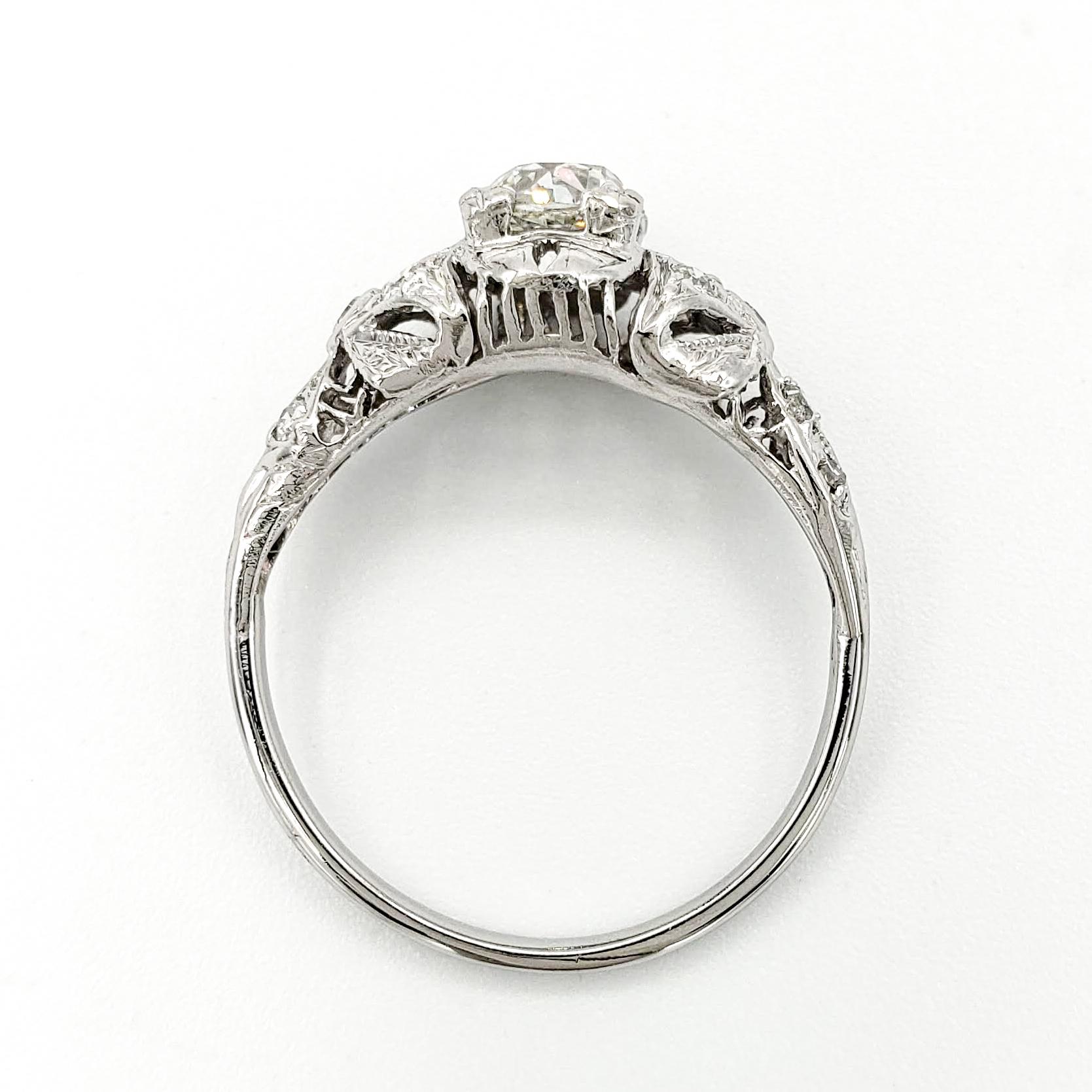 vintage-platinum-engagement-ring-with-0-80-carat-old-mine-cut-diamond-gia-j-si2