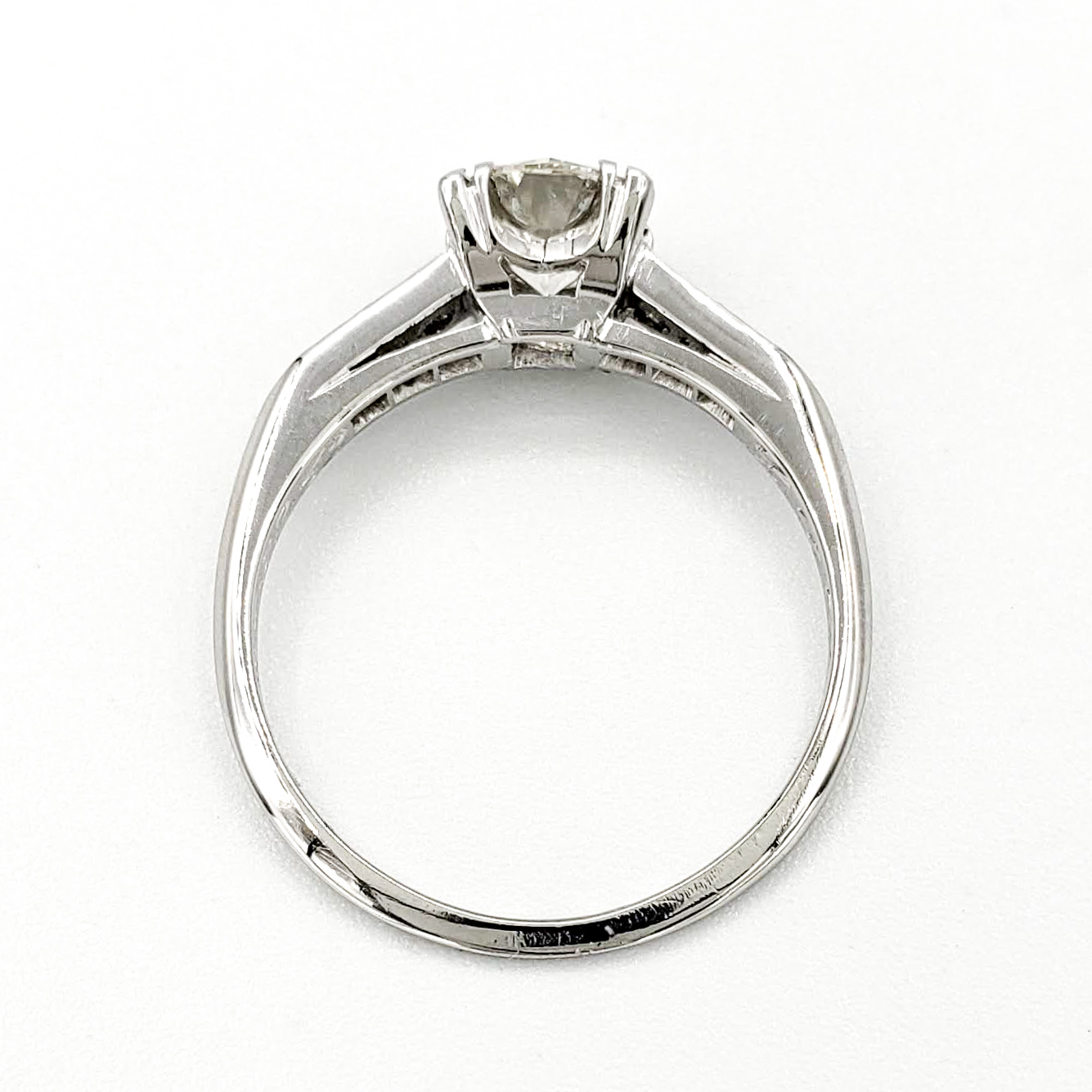 vintage-platinum-engagement-ring-with-0-68-carat-round-brilliant-cut-diamond-egl-j-vs1