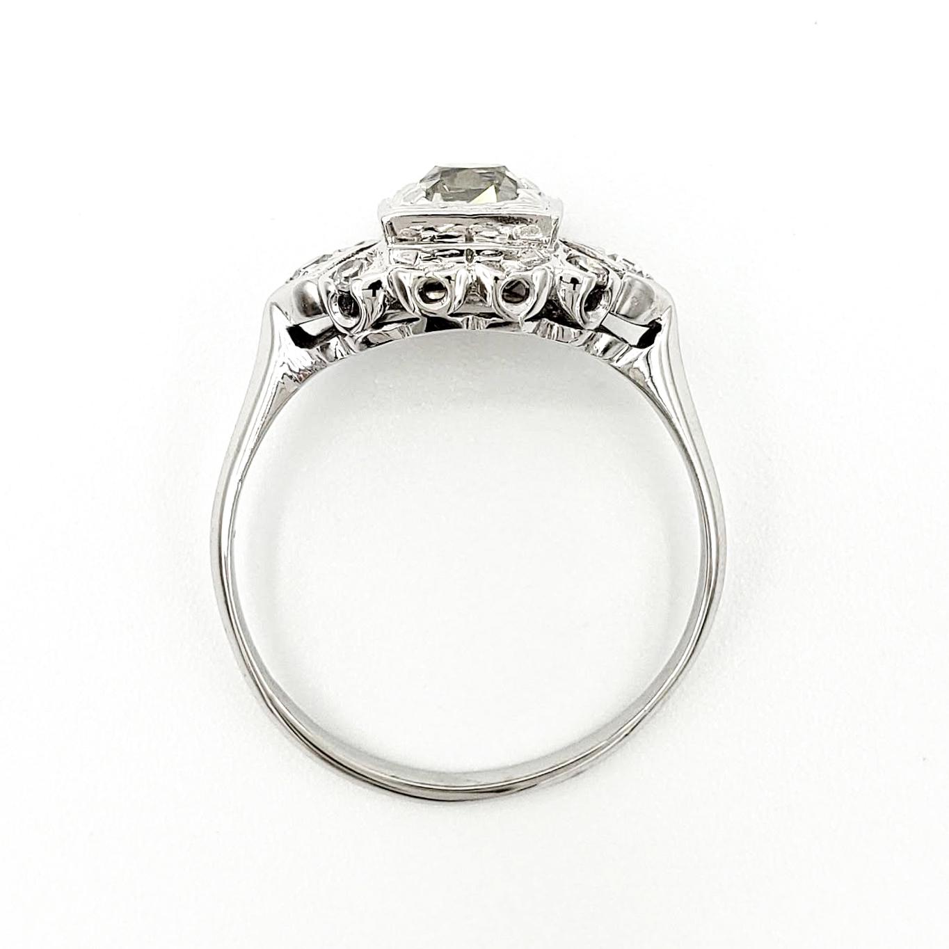 vintage-18-karat-gold-engagement-ring-with-0-86-carat-old-mine-cut-diamond-egl-k-si2