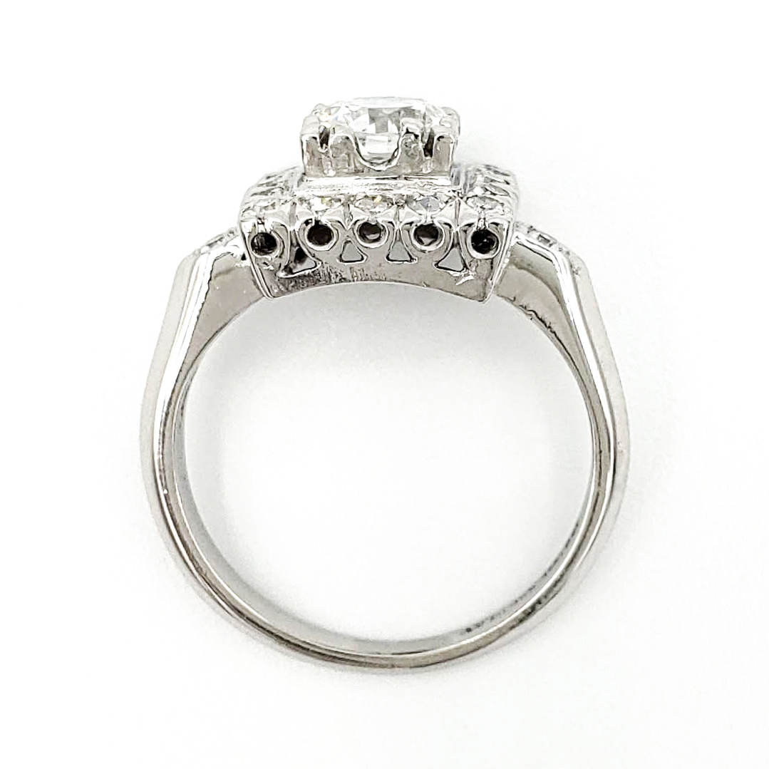 vintage-platinum-engagement-ring-with-0-58-carat-transitional-cut-diamond-gia-e-vs2
