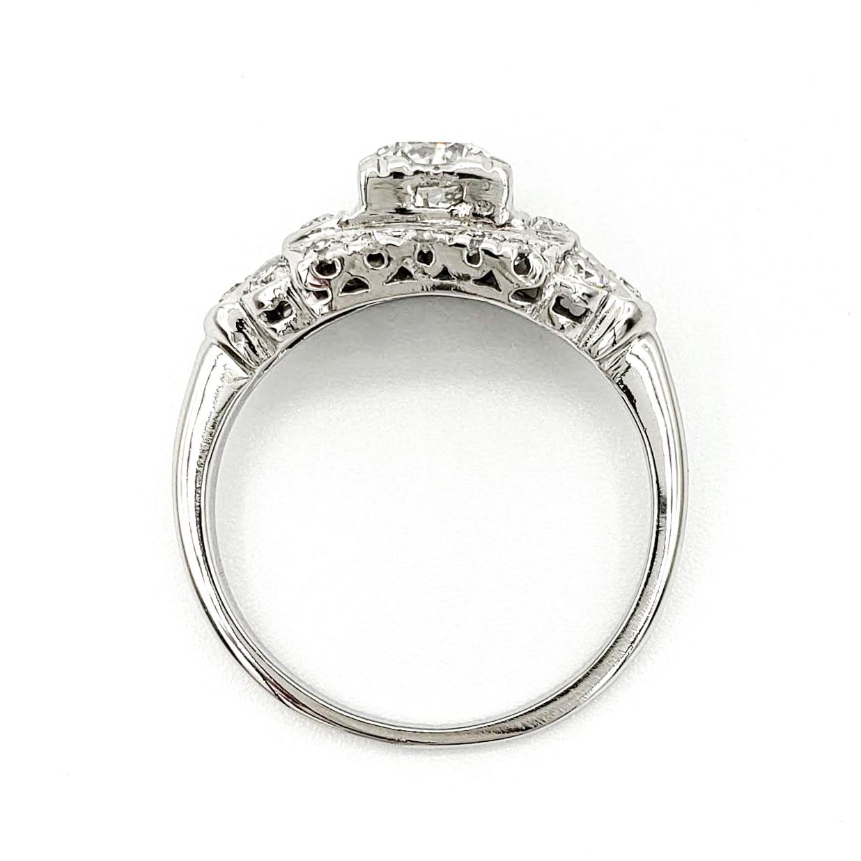 vintage-platinum-engagement-ring-with-0-55-carat-round-brilliant-cut-diamond-gia-g-si1