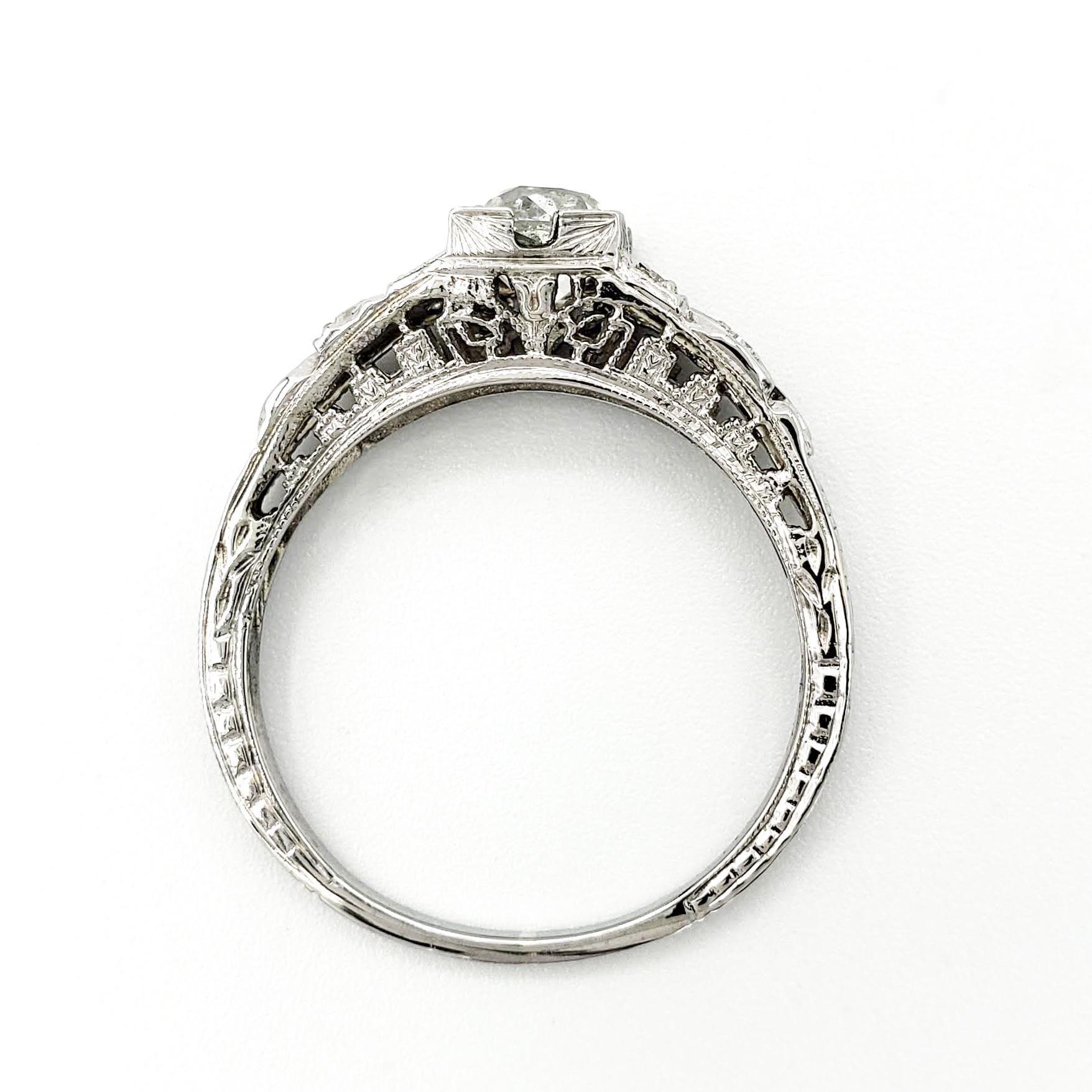 estate-platinum-engagement-ring-with-0-88-carat-old-mine-cut-diamond-gia-j-vs1