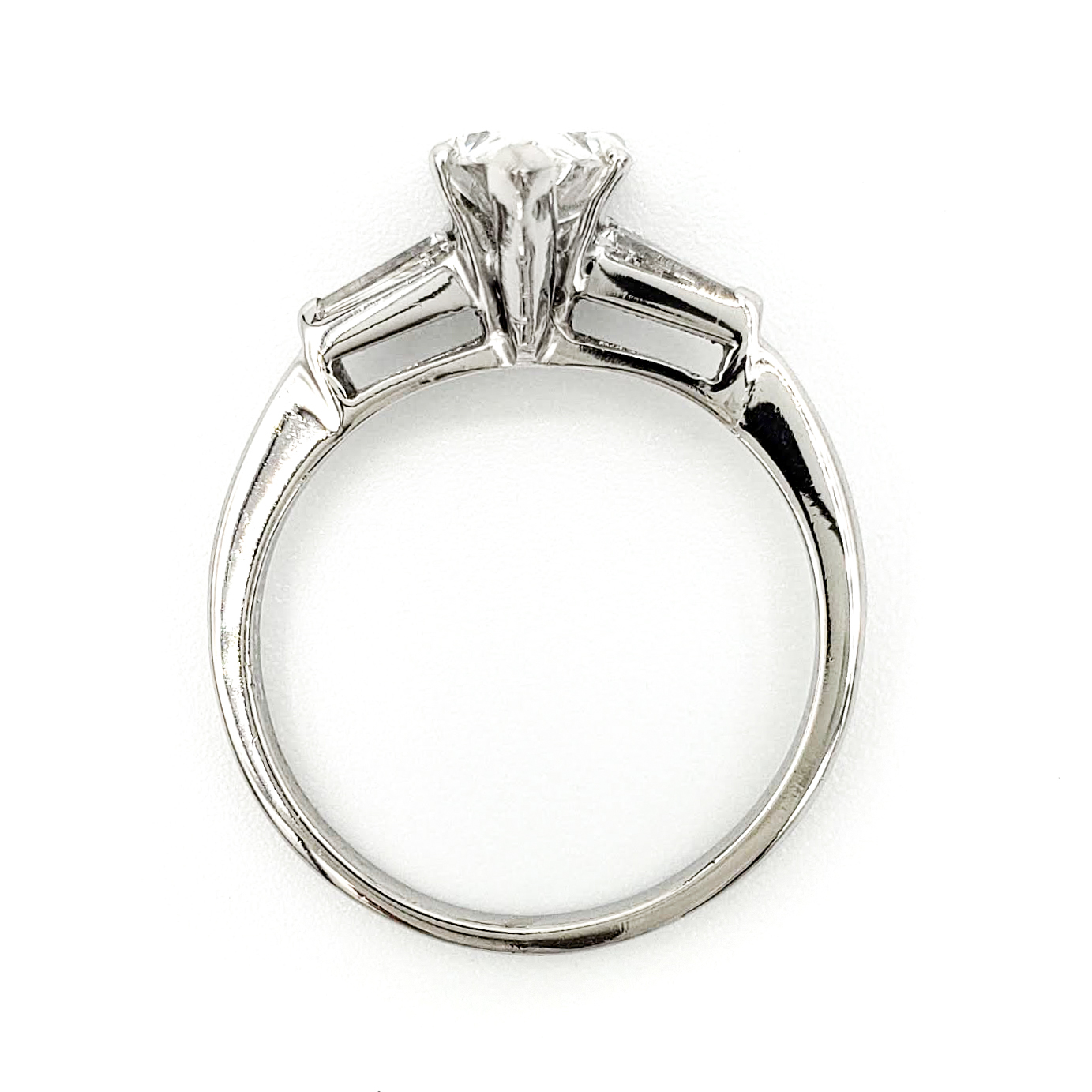 vintage-platinum-engagement-ring-with-1-16-carat-pear-brilliant-cut-diamond-egl-f-vs2