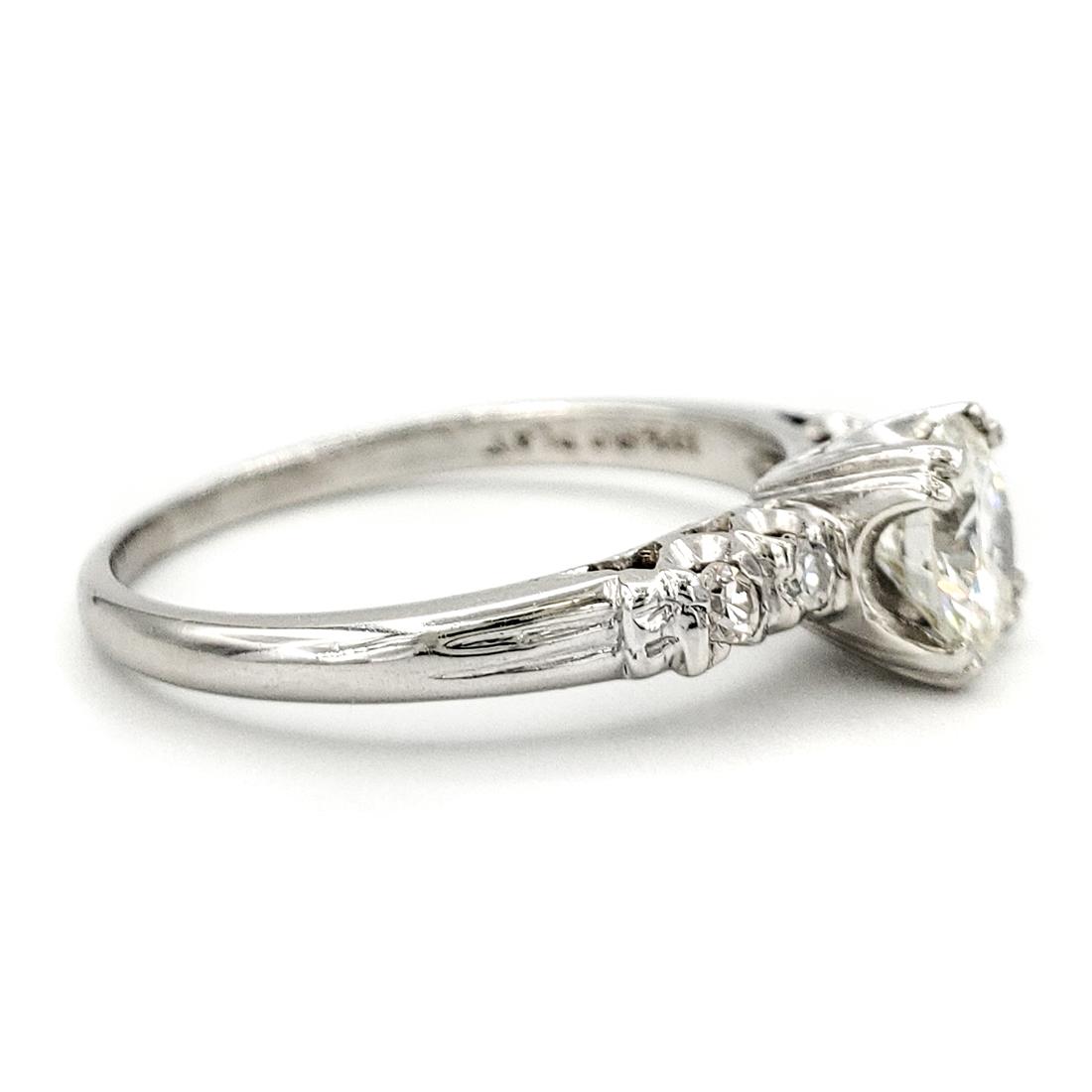 vintage-platinum-engagement-ring-with-0-61-carat-round-brilliant-cut-diamond-egl-h-si1
