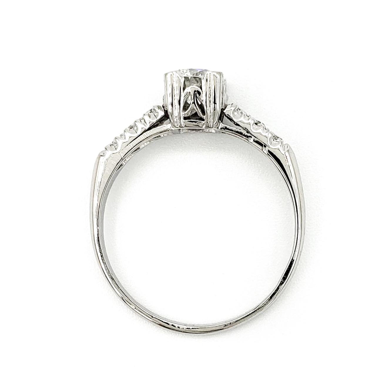 vintage-platinum-engagement-ring-with-0-57-carat-round-brilliant-cut-diamond-egl-e-vs2