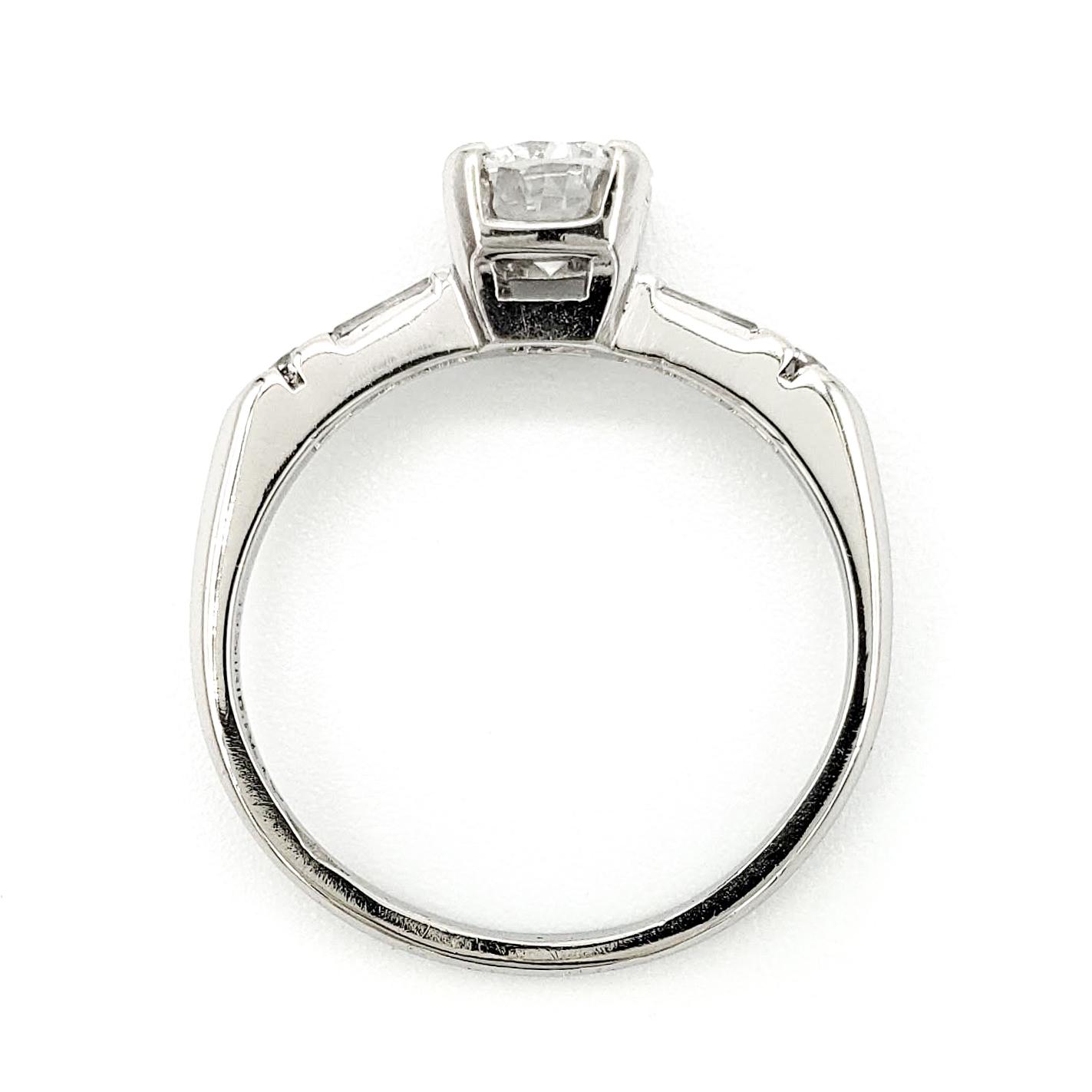 vintage-platinum-engagement-ring-with-0-57-carat-round-brilliant-cut-diamond-gia-e-vs2